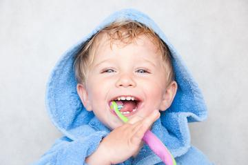 small male child with tooth brush I children's dentistry