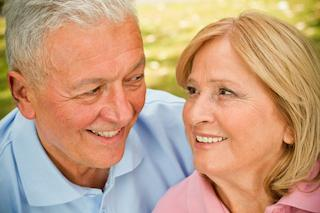 older couple facing eachother smiling brightly I root canals at woodin creek dental