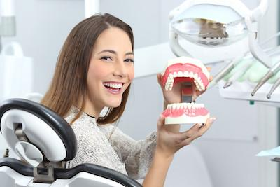 Woman holding mold of teeth l general dentist woodinville wa