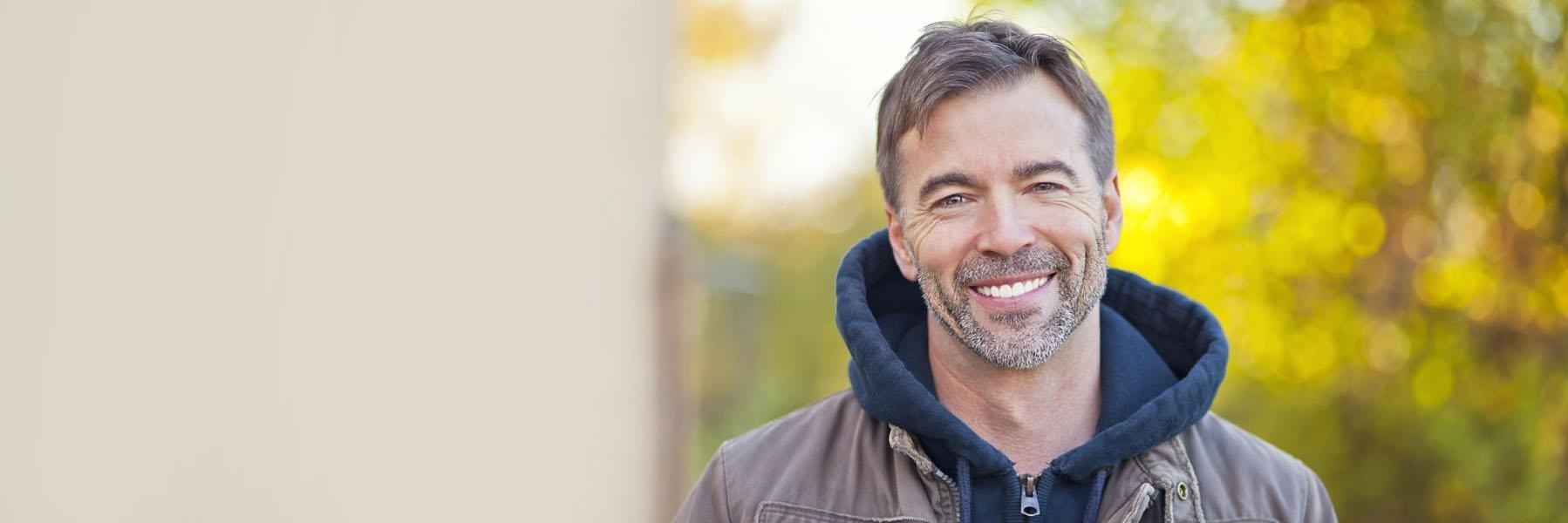 Older man with grey hair smiling l dental implants woodinville wa