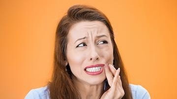 Woman with Jaw Pain | Woodin Creek Dental
